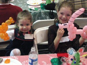 Katelyn and Samantha with their balloon pony and unicorn
