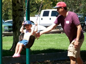 Nate and his daughter on the swings
